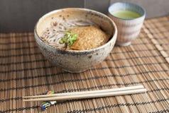 Kitsune soba, Japanese buckwheat noodles with marinated, fried tofu Royalty Free Stock Photos