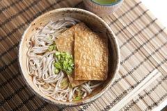 Kitsune soba, Japanese buckwheat noodles with marinated, fried tofu Stock Photo