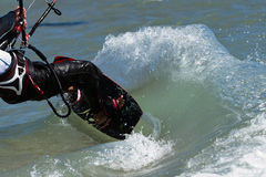 Kitsurfer with spray Stock Images