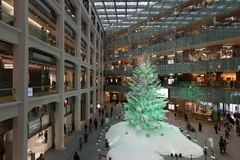 KITTE shopping mall in Tokyo, Japan. A big christmas tree inside the KITTE shopping mall in Tokyo, Japan. In front of JR Tokyo Station's Marunouchi South Gate Stock Photography