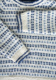 Kitted sweater. Close-up beautiful knitted sweater, white and blue Stock Photography