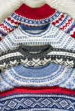 Kitted sweaters. Six knitted sweaters. Homemade with different colors and patterns. Close-up Stock Image