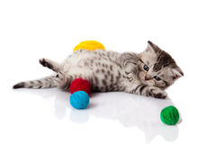 Kitten with balls of threads. Stock Photography
