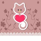 Kitten holding heart Stock Image