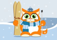 Kitten holding skis on a background of winter mountains Stock Images
