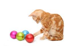 Kitten playing christmas balls Royalty Free Stock Photo