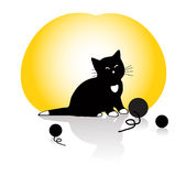 A kitten playing with knitting balls Royalty Free Stock Photography