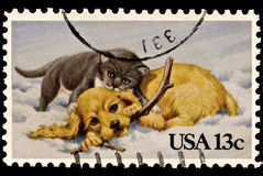 Kitten and Puppy Christmas Stamp. Puppy and a kitten playing in the snow. Issued by the United States postal Service Royalty Free Stock Photo