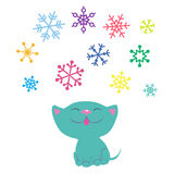 Kitten and snowflakes Stock Images