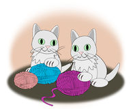 Kittens with balls of yarn Royalty Free Stock Photo