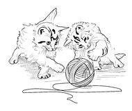 Kittens play with the hank of threads Stock Image