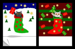 Kittens in socks with gifts, stars and trees Royalty Free Stock Image