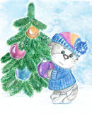 Kitty decorates a Christmas tree Stock Images