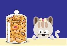 Kitty gradisce i biscotti Fotografie Stock