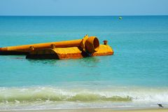 Kitty Hawk Beach Seascape with Floating Pipe. The  beauty of a Kitty Hawk, North Carolina beach as waves crash upon the shore with a backdrop of a rusted pipe Royalty Free Stock Photos