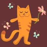 Kitty holding a flower Stock Images