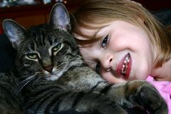 Kitty and I. Adorable little girl snuggling with her pet cat Stock Photos