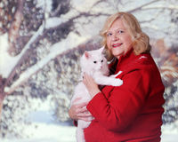 Kitty-Loving Senior in Winter Royalty Free Stock Photo