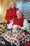 Kitty-Loving Seniors at Christmastime Stock Images