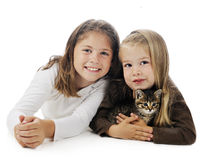 Kitty Loving Sisters Royalty Free Stock Photo
