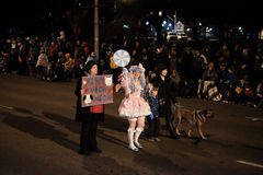 Kitty Meow Meow pet sitting service marches in holiday parade Royalty Free Stock Image