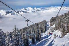 KITZBUEHEL, AUSTRIA, February 17, 2016 - Skiers on ski lift enjo Royalty Free Stock Photography