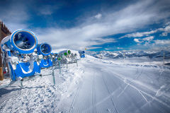 KITZBUEHEL, AUSTRIA - February 17, 2016 - Snow cannons with fres Royalty Free Stock Photos