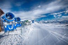 KITZBUEHEL, AUSTRIA - February 17, 2016 - Snow cannons with fres Royalty Free Stock Photos