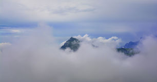 Kitzbuhel mountain peak in the mist, Tirol Royalty Free Stock Photos