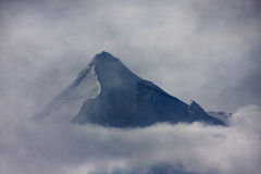 Kitzsteinhorn through the clouds Stock Photo