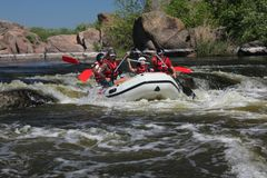 Rafting team , summer extreme water sport . stock photos