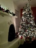 Kiva Christmas. Beautiful kiva fireplace Christmas tree stock images