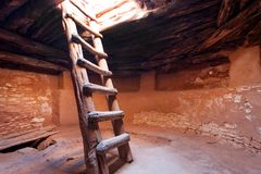 Kiva interior with the stairs. Kiva, a religious and ceremonial room of Puebloans, in Canyons of the Ancients National Monument, USA stock photos