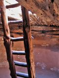 Kiva Ladder. A ladder leads down into a kiva at Edge of the Cedars State Park in Blanding, Utah stock photo