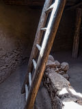 Kiva ladder. Light streams into a Native American kiva stock photography