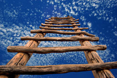 Kiva Ladder to the Sky. Conceptual image showing a kiva ladder ascending into the sky Stock Images