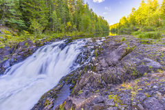 Kivach Falls. Is a 10.7-m-high cascade waterfall in Russia. It is located on the Suna River in the Kondopoga District, Republic of Karelia and gives its name to Stock Images
