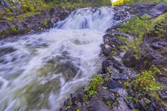 Kivach Falls. Is a 10.7-m-high cascade waterfall in Russia. It is located on the Suna River in the Kondopoga District, Republic of Karelia and gives its name to Stock Photos