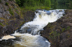 Kivach waterfall, first level. This picture shows Kivach - the most powerfull waterfall in Karelia region (approximately 12 meters royalty free stock image