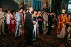 Sanctifies graduates in the church. KIVERCI, UKRAINE - June 26, 2009: Orthodox priest sanctifies graduates in the church Stock Photo