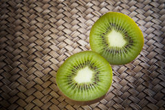 Kivi fruit on wood table Royalty Free Stock Photography
