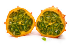 Kiwano or African horned melon. Sliced open over white. Also known as hedged gourd, African Horned Cucumber, English tomato Royalty Free Stock Images