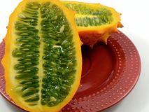Kiwano Melon (Horned Melon). Cut it half in a red plate Stock Photos