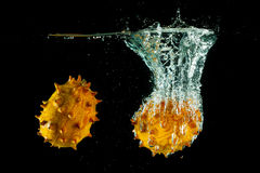 Kiwano water splash Stock Photos