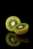 Kiwi. Fruit on black with reflection Royalty Free Stock Photos