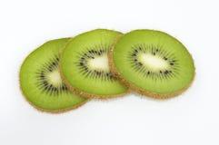 Kiwi. Fruit slices on a white background Royalty Free Stock Images