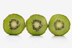 Kiwi. Slice of kiwi over white background Stock Images