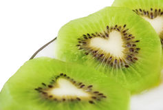 Kiwi. With love hearts on a plate Stock Images