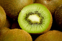 Kiwi. Green fresh kiwi fruit cut on pile of kiwis Stock Image