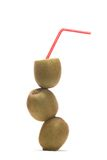 Kiwi. Fruits with a straw on a white background Royalty Free Stock Photo